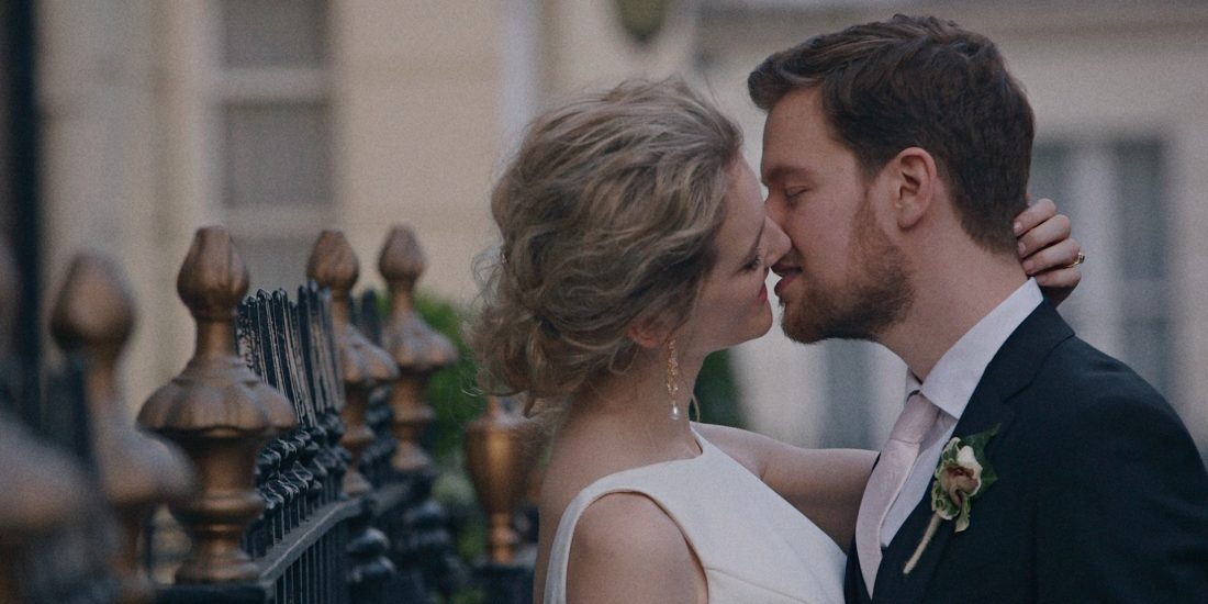Cameron and Mackenzie embrace in a Kiss at their wedding